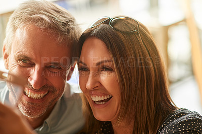 Buy stock photo Shot of a mature couple mature couple enjoying some wine together at a restaurant