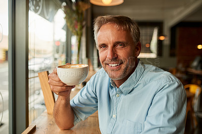 Buy stock photo Shot of a mature man having coffee at a cafe