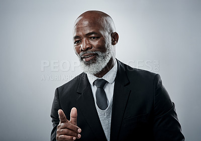 Buy stock photo Studio shot of a mature businessman gesturing against a grey background