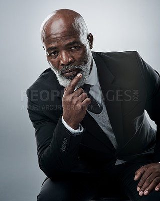 Buy stock photo Studio portrait of a mature businessman looking thoughtful against a grey background