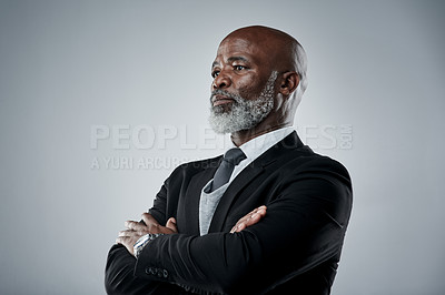 Buy stock photo Studio shot of a mature businessman against a grey background