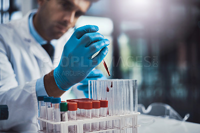 Buy stock photo Cropped shot of a young male scientist working in a lab