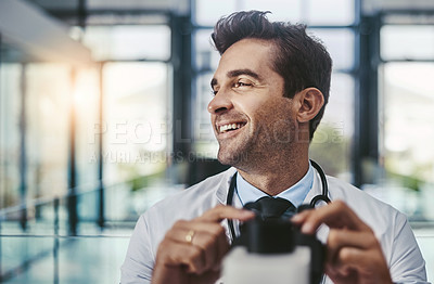 Buy stock photo Cropped shot of a young handsome male scientist working in a lab with a microscope