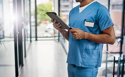 Buy stock photo Cropped shot of an unrecognizable male medical practitioner working in a hospital