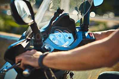 Buy stock photo Cropped shot of an unrecognizable man riding a motorbike