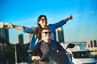 Buy stock photo Cropped shot of a young couple out for a ride in the city