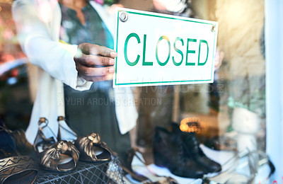 Buy stock photo Cropped shot of an unrecognizable woman holding up a closed sign