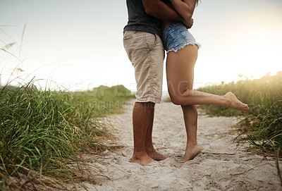 Buy stock photo Cropped shot of a young couple spending a romantic day at the beach
