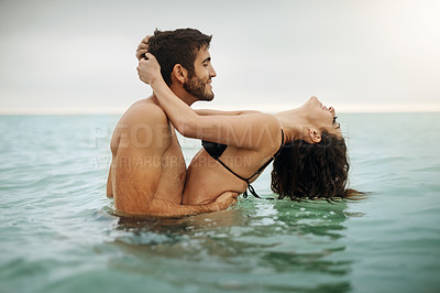 Buy stock photo Shot of a young couple spending some time in the water