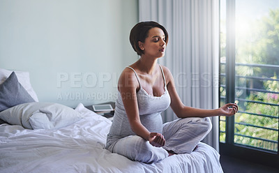 Buy stock photo Shot of a pregnant woman doing yoga in her bedroom