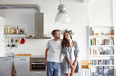 Buy stock photo Shot of a young couple spending time together in the morning at home