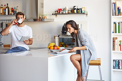 Buy stock photo Shot of a young couple going through their morning routine together at home