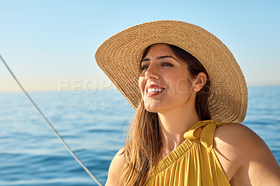 Buy stock photo Shot of a beautiful young woman going for an ocean cruise on a boat
