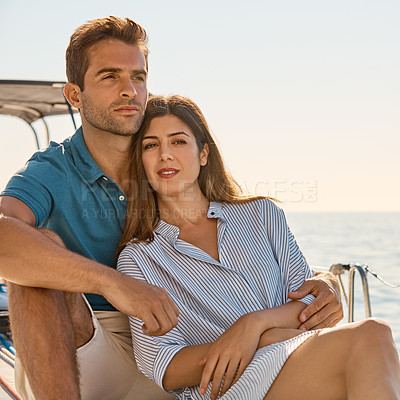 Buy stock photo Shot of a young couple enjoying a cruise out on the ocean
