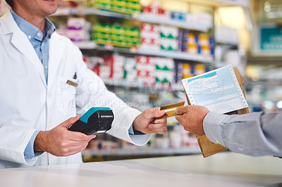 Buy stock photo Cropped shot of an unrecognizable male pharmacist helping a customer in the pharmacy
