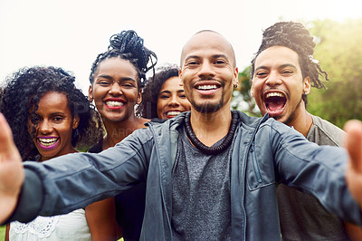 Buy stock photo Cropped shot of a group of friends posing together for a selfie