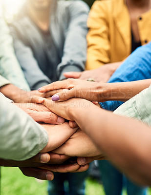Buy stock photo Cropped shot of a group of people joining their hands together