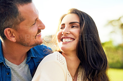 Buy stock photo Shot of a happy couple bonding together outdoors