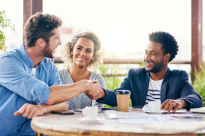 Buy stock photo Shot of businesspeople shaking hands during a meeting outdoors