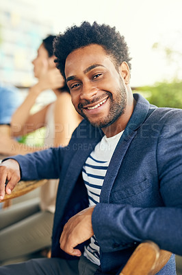 Buy stock photo Portrait of a young businessman having a meeting with his colleagues outdoors