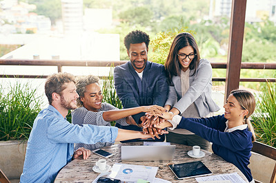 Buy stock photo Shot of a group of businesspeople joining their hands together in unity during a meeting outdoors