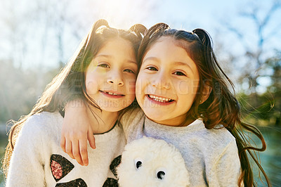 Buy stock photo Cropped shot of two adorable little girls holding each other outdoors