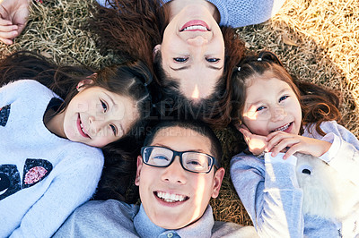 Buy stock photo High angle shot of a happy family spending time together outdoors