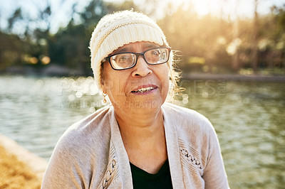 Buy stock photo Portrait of a senior woman standing next to a lake