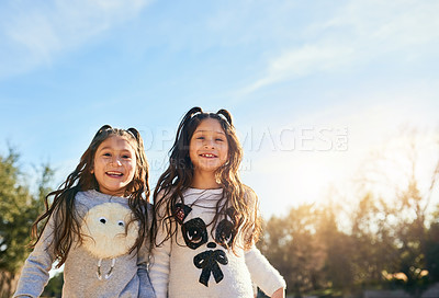 Buy stock photo Cropped shot of two adorable little girls outdoors