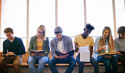Buy stock photo Shot of a group of university students studying at campus