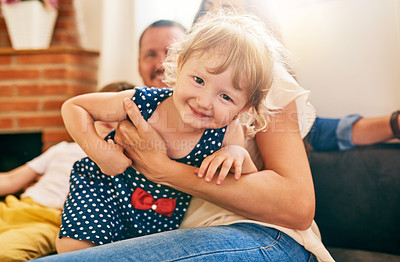 Buy stock photo Portrait of a happy little girl spending quality time with her family at home