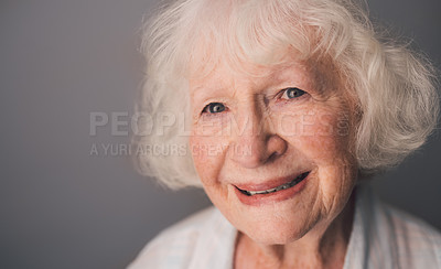 Buy stock photo Shot of a happy senior woman against a gray background