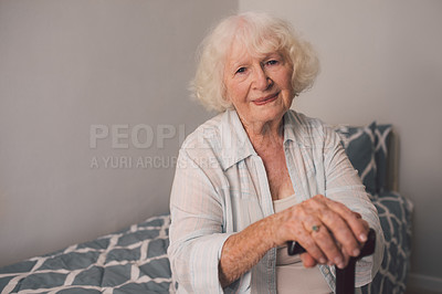 Buy stock photo Shot of a senior woman and a cane in her bedroom at a retirement home