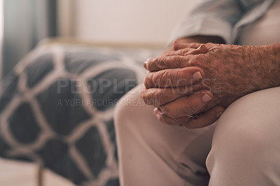 Buy stock photo Cropped shot of a senior woman sitting with her hands clasped in a retirement home