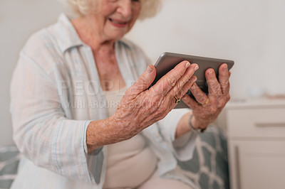 Buy stock photo Shot of a senior woman using a digital tablet in a retirement home