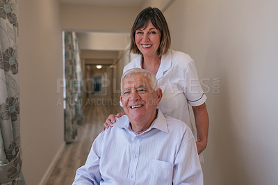 Buy stock photo Shot of a senior man in a wheelchair being cared for by a nurse in an old age home