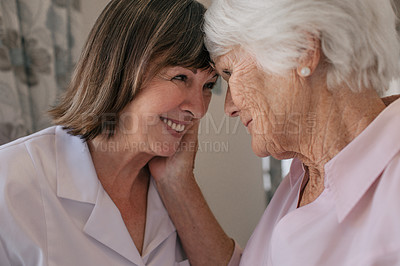 Buy stock photo Shot of a senior woman bonding with a nurse in a retirement home