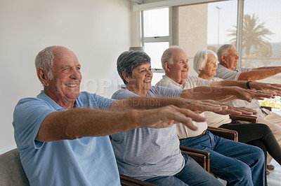 Buy stock photo Shot of a group of senior people working out together in a retirement home