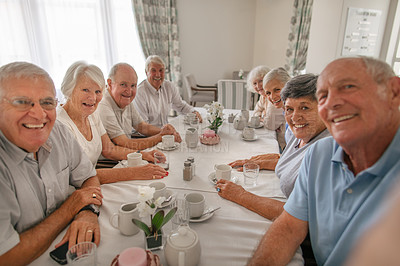 Buy stock photo Shot of a group of senior people taking a selfie while having coffee together at a retirement home
