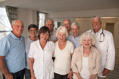 Buy stock photo Portrait of a group of senior people standing together with a nurse in a retirement home