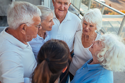 Buy stock photo Shot of a group of seniors talking to each other outside