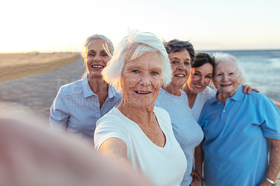 Buy stock photo Shot of a group of seniors taking a selfie outdoors