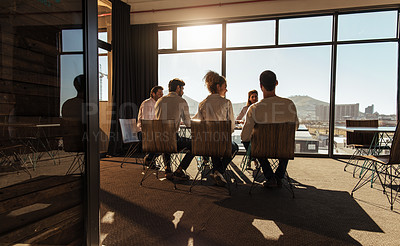 Buy stock photo Shot of a group of businesspeople having a boardroom meeting in an office