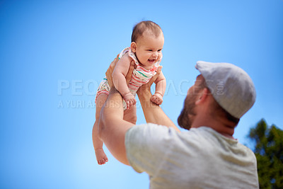 Buy stock photo Shot of a young man having fun with his adorable baby girl outdoors