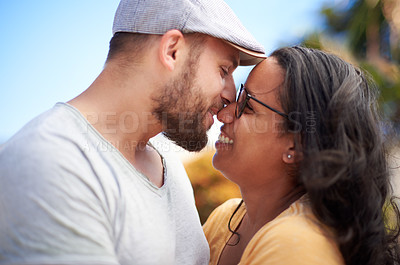 Buy stock photo Shot of a happy young couple spending time together outdoors