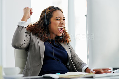 Buy stock photo Cropped shot of an attractive young female call center agent celebrating while working in her office