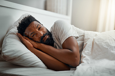 Buy stock photo Cropped shot of a handsome young man waking up in bed at home