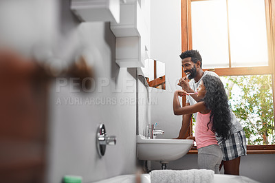 Buy stock photo Cropped shot of a handsome young man and his daughter brushing their teeth in the bathroom at home