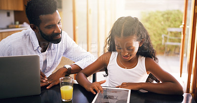 Buy stock photo Cropped shot of a young father and his adorable daughter using a tablet at home