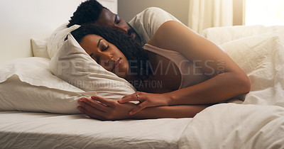Buy stock photo Cropped shot of a young attractive couple sleeping in bed at home
